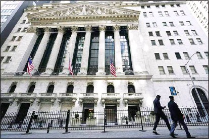??  ?? In this file photo, pedestrians walk past the New York Stock Exchange in New York's Financial District. Wall Street is gearing up for a blockbuster corporate earnings season, Thursday, July 8, as companies issue their results for the April-June quarter. (AP)
