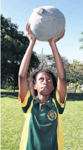 ??  ?? Grantham Park Primary School's Aphiwe Ngcobo concentrates at the medicine ball lift station