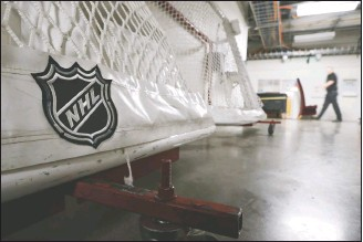 ?? AP PHOTO/MARK HUMPHREY, FILE ?? In this March 12 file photo, goals used by the NHL's Nashville Predators are stored in a hallway in Bridgestone Arena in Nashville, Tenn. The NHL and players reached a tentative deal Friday to hold a 56-game season in 2021, pending the approval of each side's executive board and Canadian health officials.