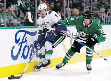 ?? THE ASSOCIATED PRESS/FILES ?? Defenceman Derrick Pouliot, left, has a much better chance at playing time and success with the Vancouver Canucks than Ben Hutton does, but the 24-year-old would also be a much more valuable trade chip if the team is looking to clear out room for Quinn Hughes.