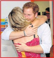??  ?? The Prince enjoys a chat and a hug with Joss while Chelsy Davy, below, relaxes at Glastonbury at the weekend