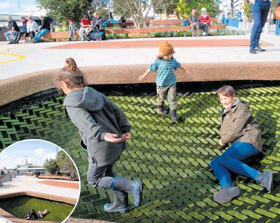 ?? Photo / Sylvie Whinray ?? Artist Tessa Harris plays with her mokopuna Noah Harris, 6, and Casey Harris, 3, on the newly installed interactive work in downtown Auckland.