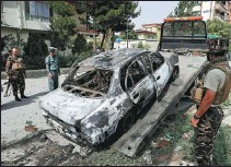 ?? RAHMAT GUL / ASSOCIATED PRESS ?? Security personnel inspect a destroyed vehicle believed to have been used to launch rockets in the attack on Tuesday in Kabul, Afghanistan.