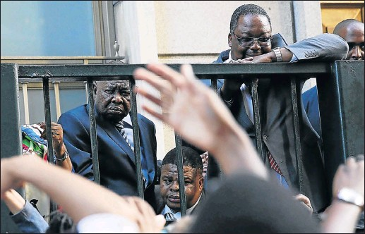?? Picture: THE TIMES ?? Higher Education and Training Minister Blade Nzimande, left, stands in the psychic void between fantasy and reality as he is faced with students protesting at Parliament.