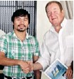 ?? HANDOUT/ WATEROTOR Energy TECHNOLOGIES ?? Ottawa inventor Fred Ferguson, right, and Filipino congressman and boxing star Manny Pacquiao met last year and 'got along great,' Ferguson said.