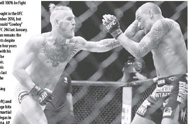 ?? AP ?? Conor Mcgregor (left) and Dustin Poirier exchange hits during their mixed martial arts bout in Las Vegas in September 2014.