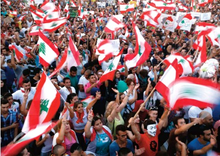 ??  ?? YouStink protesters carry Lebanese flags during a rally in Beirut in August 2015.