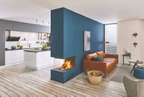 ??  ?? A colourful feature wall with built-in three-sided gas fireplace serves as an eye-catching decor feature and serves to divide the living area from the kitchen.