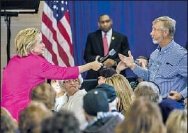 """?? Brendan Hoffman Getty Images ?? """"I WANT TO BUILD on what we've already achieved,"""" Hillary Clinton said in Clinton, Iowa, emphasizing progress on healthcare under President Obama."""