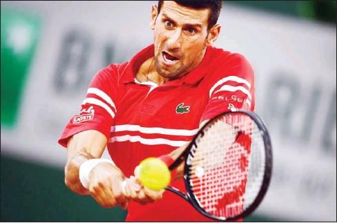 ?? AFP ?? Novak Djokovic returns the ball to Tennys Sandgren of the US during their men's singles first round tennis match on June 1.