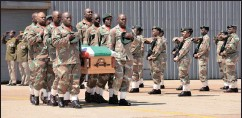 ?? PICTURE: OUPA MOKOENA / ANA ?? The mortal remains of Nomathemba Ngeleka, of the SANDF, who died in the DRC, arrive at Air Force Base Waterkloof.