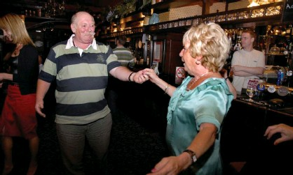 ?? Photograph: Janine Wiedel Photolibrary/Alamy ?? 'A place for connections': revellers in a south London pub.
