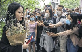 ?? PHOTOGRAPH: MARK SCHIEFELBEIN/AP ?? ▲ Zhou Xiaoxuan arrives at court yesterday