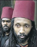 ?? National Post photo: Tyler Anderson ?? CONCERNED: Moorish-American Grand Sheik Kudjo Adwo Sut Tekh El, right, speaks with members of the media Monday with Hanif Ali Amimn in front of College Park Cour in Toronto.