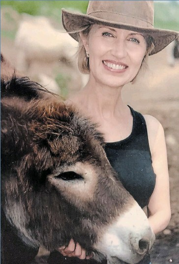 ??  ?? Animal rights activist Regan Russell volunteered at a donkey sanctuary located near Guelph.
