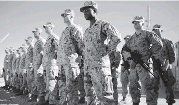 ?? MASSOUD HOSSAINI AP file ?? U.S. Marines watch during the change of command ceremony at Task Force Southwest military field in Shorab military camp of Helmand province, Afghanistan in April 2018. The final phase of ending America's 'forever war' in Afghanistan formally began Saturday, with the withdrawal of the last U.S. and NATO troops by the end of summer.