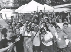 ??  ?? DAVAOEÑOS who witnessed the Pacquiao-Thurman bout at ReHub gesture the victory cheers after seeing the Filipino boxing icon win via unanimous decision.