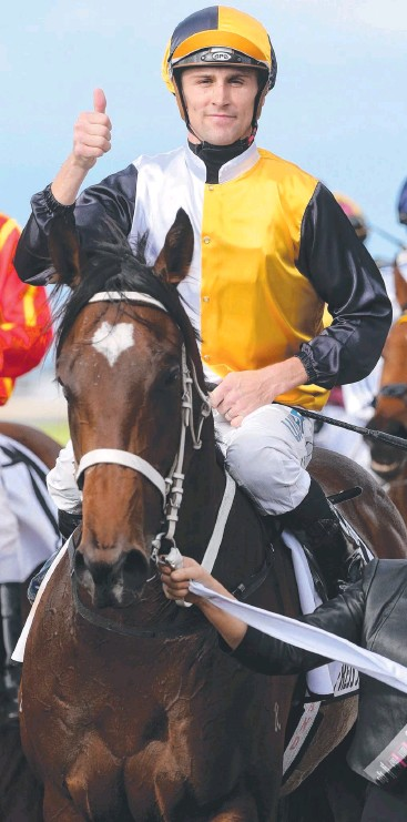 ??  ?? UNBEATEN AT TWO: Tye Angland gives the thumbs up after Press Statement won the J.J. Atkins Stakes at Doomben in June. Picture: Jono Searle