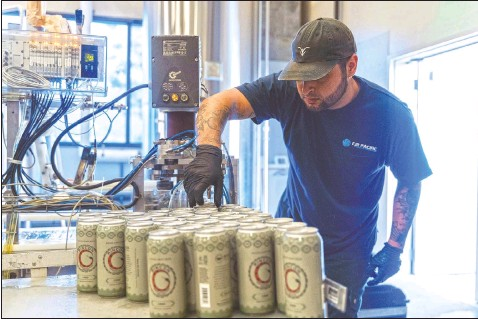 ?? (Harrah's Resort Southern California/Indian Country Today) ?? A worker from Mobile West Canning cans Luiseno Hazy IPA on June 30 at the Rincon Reservation Road Brewery in Valley Center, Calif.