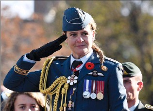?? CP FILE PHOTO ?? Governor General Julie Payette salutes during the march past during the 2017 National Remembrance Day Ceremony at the National War Memorial in Ottawa. Payette resigned the position on Thursday.