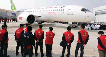 ??  ?? ... China's first big passenger plane C919, a narrow-body jet which can seat 168 passengers, goes on display at a facility in Shanghai yesterday. The C919 rolled off the assembly line as China seeks to develop its own aviation sector and challenge...