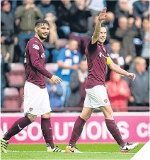 ??  ?? Hearts' Dow Cowie (right) celebrates his opener.