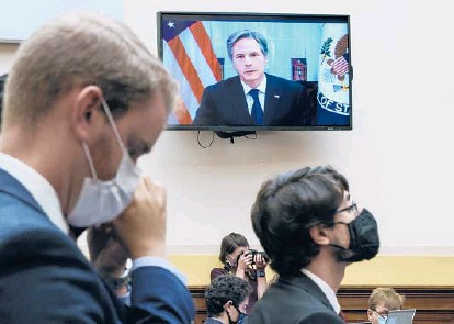 ?? J. SCOTT APPLEWHITE/AP ?? Secretary of State Antony Blinken appears remotely on a TV monitor to answer questions from the House Foreign Affairs Committee about the U.S. withdrawal from Afghanistan, on Monday at the Capitol in Washington.