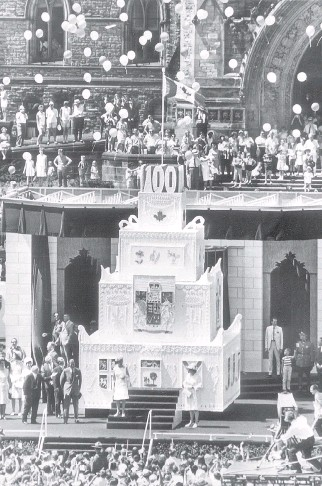 ??  ?? The Centennial cake, 1967, was constructed of plywood, nails and Styrofoam. But it had an insert of real cake in the front, for the Queen to cut, and was coated with real icing, made with 700 pounds (317 kg), of icing sugar.