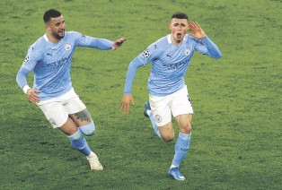 ??  ?? Manchester City's Phil Foden (R) celebrates with teammate Kyle Walker after scoring against Borussia Dortmund in the UEFA Champions League quarterfinal, second leg match in Dortmund, Germany, April 14, 2021.