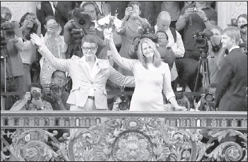 ?? JEFF CHIU / ASSOCIATED PRESS ?? Kris Perry (left) and Sandy Stier celebrate their marriage at City Hall in San Francisco Friday. Stier and Perry were married after a federal appeals court on Friday cleared the way for the state of California to immediately resume issuing marriage    ...