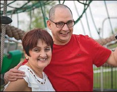 ?? Courtesy of Carlos Montanez ?? Marita Bernal and her son, Fernando Corredor, at their Riverview home. Corredor was diagnosed with autism when he was 2 years old. Today, at age 49, he writes poetry and has published two books.