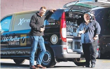 ??  ?? MOBILE: Jonathan Payne, owner of Xpresso Mobile Café with Phillip Di Bella and new coffee van franchise model. Picture: Adam Smith