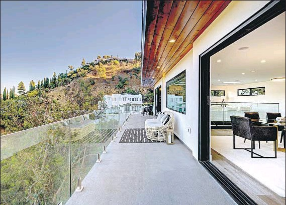 ?? Photographs by Ian Denker Omega Images ?? WITH CANYON VIEWS, this Hollywood Hills home has an open-concept f loor plan that has been updated with a fresh aesthetic.