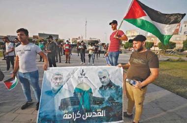 ??  ?? Iraqi demonstrators lift Palestinian flags and a banner depicting slain top Iranian commander Qasem Soleimani (right) and slain Iraqi commander Abu Mahdi al-Muhandis during a anti-Israel protest in Baghdad, yesterday.
