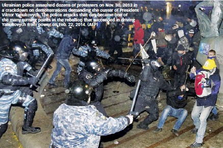 ??  ?? Ukrainian police assaulted dozens of protesters on Nov. 30, 2013 in a crackdown on demonstrations demanding the ouster of President Viktor Yanukovych. The police attacks that day became one of the many turning points in the rebellion that succeeded in driving Yanukovych from power on Feb. 22, 2014. (AFP)