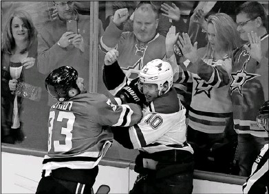 ?? Tony Gutierrez/The Associated Press ?? Fans pounded on the glass as the Stars' Marc Methot and the Blues' Brayden Schenn fought after the final buzzer of Friday's game. Methot's return gives the Stars a physical presence and, they hope, a perfect defense partner for Stephen Johns.
