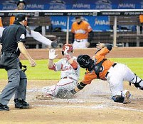 ?? WILFREDO LEE/AP ?? Philadelphia's Chase Utley slides into home to score on a single by Ryan Howard as Miami catcher Jhonatan Solano attempts the tag during the seventh inning on Sunday.