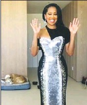 ?? E! Entertainment ?? REGINA KING opts for a custom draped-cape silk cady Louis Vuitton gown with silver and gold sequins.