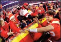 ?? Associated Press photo ?? Fans congratulate Kansas City Chiefs quarterback Patrick Mahomes, right, as he comes off the field after an NFL divisional playoff football game against the Houston Texans, Sunday in Kansas City, Mo.