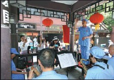 ?? SUN JIDONG / FOR CHINA DAILY ?? People sing 'red', or revolutionary, songs in the street in Zunyi in 2019.
