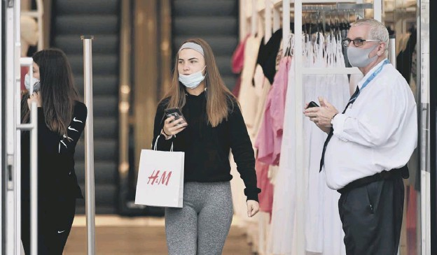 ?? PICTURE: JOHN DEVLIN ?? 0 Some shoppers have ventured out since lockdown has been eased but overall retail sales remain down overall