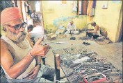 ??  ?? A worker making surgical instruments at the Sports and Surgical Complex in Jalandhar. HT PHOTO