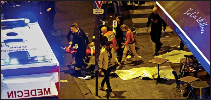 ?? Picture: REUTERS ?? Massacre: Bodies are covered in white sheets as rescue workers help survivors at Le Carillon restaurant in Paris on Friday