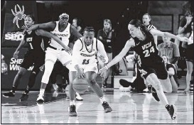 ?? 2020, TIMES- DISPATCH ?? Richmond's Alex Parson and VCU's Tera Reed battled for the ball in February at the Robins Center. Parsonwill make her 63rd straight start in the Spiders' season opener.