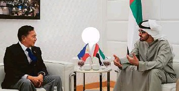 ?? WAM ?? Diplomacy Shaikh Mohammad in discussion with Jejomar Binay in Abu Dhabi yesterday. Left: Binay at a lunch with distressed Filipinas being temporarily sheltered at the Philippine Embassy.