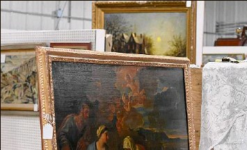 ?? Photos by Will Waldron / Times Union ?? Paintings from the estate of Paul Verbitsky are displayed at Mooney's Auction House on Monday in Freehold. The pieces go up for auction on Saturday.