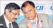 ?? PTI ?? M&M chief financial officer VS Parthasarathy (left) with RBI deputy governor HR Khan in Mumbai on Friday