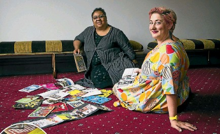 ?? PHOTOS: ROSA WOODS/STUFF ?? The New Zealand Fringe Festival's Wellington director, Hannah Clarke, right, compares notes with her New Zealand Festival counterpart Shelagh Magadza as they look back at old Fringe booklets.
