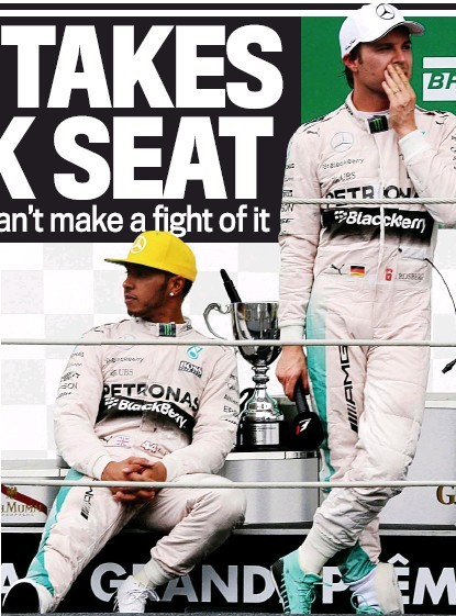 ?? REUTERS ?? Second best: Hamilton (left) looks bored on the podium after trailing in behind rival Rosberg