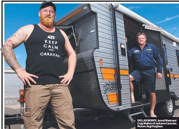??  ?? DOLLAR WORRY: Jarrod Wade and Craig Walters of Jackaroo Caravans. Picture: Regi Varghese